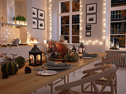 A fresh interior decorated for the holidays with a turkey served on the dining table.