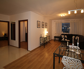 A cozy condo interior. Walls are painted a neutral white to enhance the brown furniture and decorations.