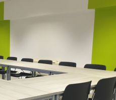Freshly painted white and green walls in a commercial conference room in Chicago.